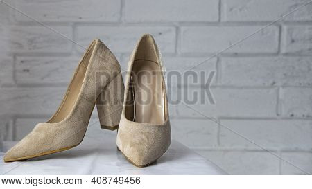 Beige High-heeled Shoes. Women's Shoes With Heels. A Pair Of Beige Patent Leather Women's Shoes On A