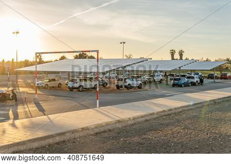 Campos, Spain; February 16 2021: Parking Lot Of The Sports Complex In The Town Of Campos At Sunset,