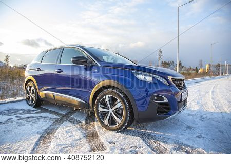 Moscow, Russia - March 15, 2020: Blue Suv Peugeot 3008 Against The Backdrop Of A Winter Landscape In
