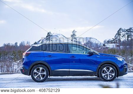 Moscow, Russia - March 15, 2020: Side View Of Blue Suv Peugeot 3008 On On Winter Landscape