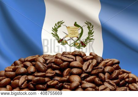 Roasted Coffee Beans On The Background Of The Flag Of Guatemala. Concept: Best Flavored Coffee, Expo