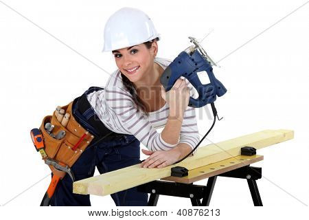 Young woman using a jigsaw