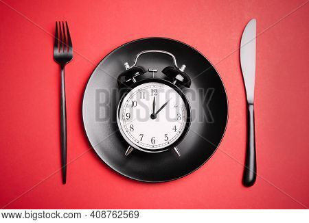 Alarm Clock, Plate And Cutlery On Red Background, Flat Lay. Diet Regime