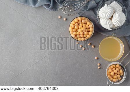 Flat Lay With Yummy Meringues, Aquafaba And Boiled Chickpeas On Grey Table, Copy Space. Egg Substitu