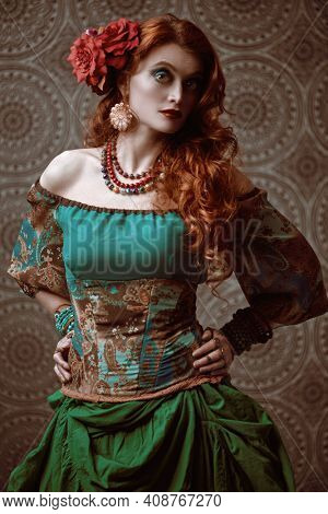 Portrait of a beautiful redhead gypsy woman in national gypsy costume. Make-up and hairstyle. Ethnic concept.