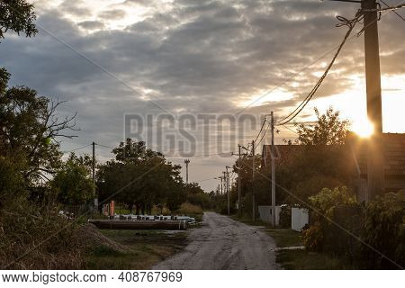 Unpaved Non Asphalted Road And Street, A Dirtpath, In A Village At Sunset In Ovca, A Rural Settlemen
