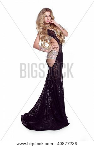 Slim Beautiful Woman With Long Hair Wearing Luxurious Dress Over White