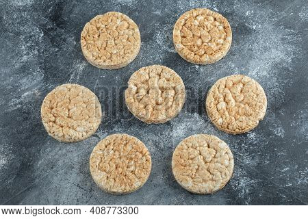 Many Crunchy Rice Cakes On Marble Background