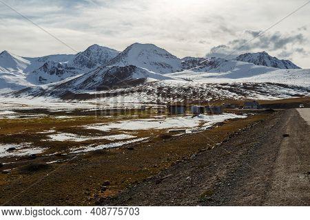Snowy Mountain Peaks On The Ala Bel Pass, Bishkek Osh Highway M41 In Kyrgyzstan