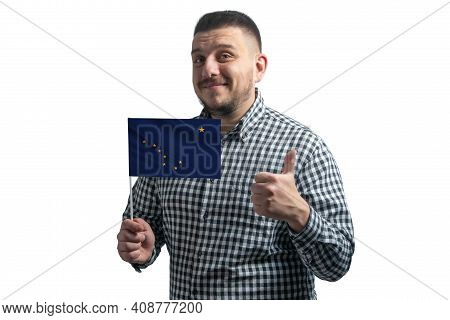 White Guy Holding A Flag Of Alaska And Shows The Class By Hand Isolated On A White Background. Like
