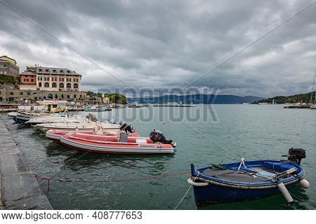 Porto Venere, Italy - October 2020: View Of Sea Side Walk With Boats On Blue Waters Of Mediterranean