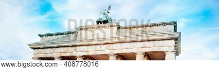 detail of the top section of the popular Brandenburg Gate in Berlin, Germany, one of the main landmarks in the city, in a panoramic format to use as web banner or header