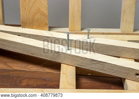 Woodwork. Wooden Slats Fastened Together. Self-tapping Screw Screwed Into A Wooden Lath.