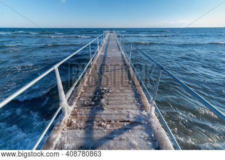 Slippery Frozen Pier In Denmark Baltic Sea Scandinavia