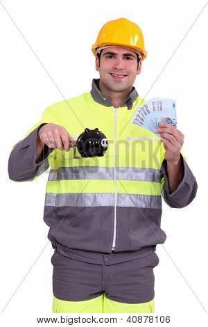 Hardworking man with his hard-earned savings
