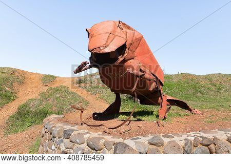 Qatsrin, Israel, February 13, 2021 : A Dinosaur Sculpture Made From Scrap Metal Left Behind By Soldi