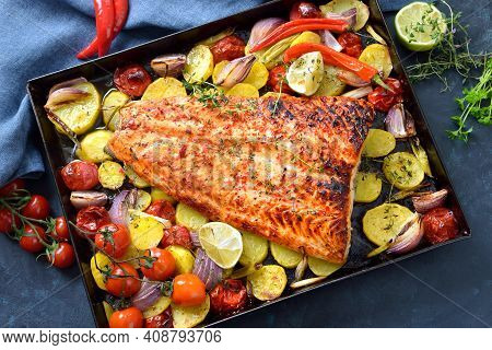 Large Juicy Salmon Fillet With A Chili Honey Marinade, Baked With Vegetables And Served Hot From The