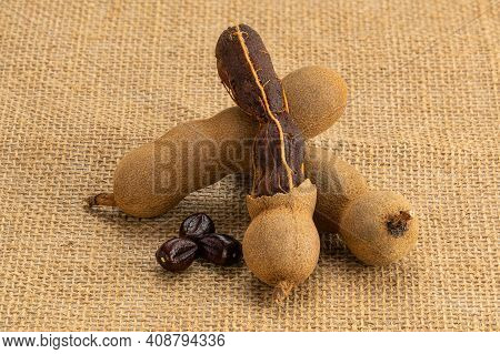 Whole And Peeled Ripe Tamarind With Seeds On Sackcloth.tamarind Is A Good Laxative Food For Human.