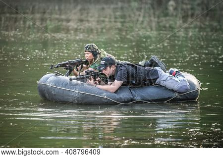 Soldier Training. Special Forces Paddling Military Rubber Boat. Diversionary Mission
