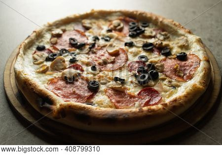 Delicious Italian Pizza With Sausage And Mozzarella Close-up On A Gray Background. Ready-made Pastri