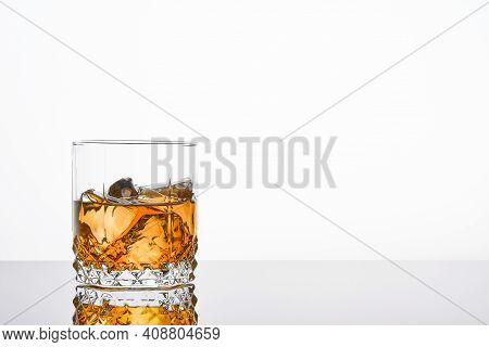 Whiskey With Ice Or Brandy In Glass With Cigar On White Background. Whisky With Ice In Glass. Whiske