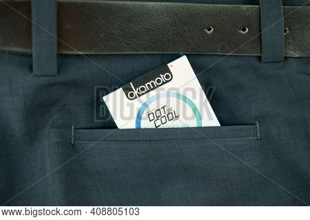 Samut Prakan, Thailand - February 18, 2021 : Box Of Okamoto Dot De Cool Condom 52mm In Man Blue Slac