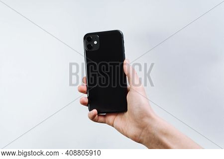Samara Russia - 04.05.2020: A Young Man Holding In A Smartphone In Hand. The Back Of The Iphone 11,