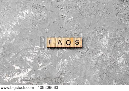 Faqs Word Written On Wood Block. Faqs Text On Table, Concept.