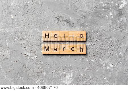 Hello March Word Written On Wood Block. Hello March Text On Table, Concept.