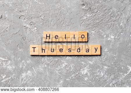 Hello Tuesday Word Written On Wood Block. Hello Tuesday Text On Cement Table For Your Desing, Concep