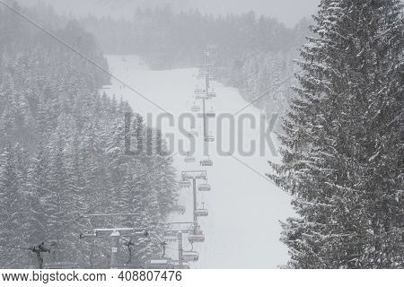 A Chairlift In A Ski Region For Transporting Skiers To The Mountain Top