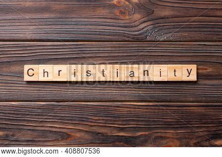 Christianity Word Written On Wood Block. Christianity Text On Table, Concept.