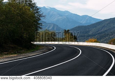 Asphalt Road. Paved Road On The Background Of Mountains. Road On The Background Of Beautiful Mountai