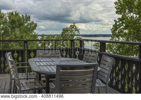 Overview Of Outdoor Wooden Veranda Around Private House With Gorgeous Landscape  On Baltic Sea. Beau
