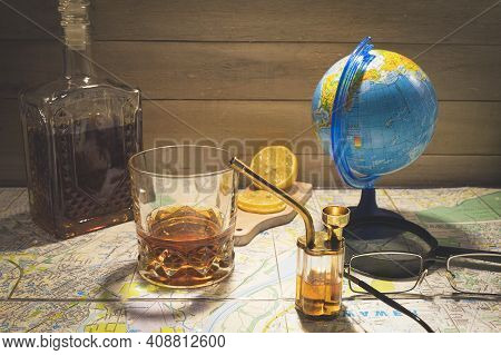 Glass Bong For Smoking Marijuana With Copy Space. Alcohol With Lemon And Drugs With A Hookah On The
