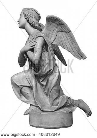 Angel statue isolated on white background. White stone sculpture of praying cherub