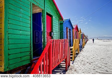 Row Of A Beach Huts At Muizenberg Beach, Cape Town, South Africa. Colorful Huts On The Beach.