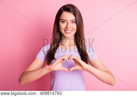 Photo Portrait Of Pretty Girl Keeping Hands In Heart Shape Smiling Isolated On Pastel Pink Color Bac