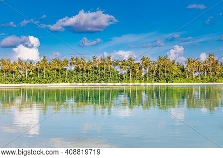 Beautiful Lush Tropical Palm Trees Against Blue Sky With White Clouds Are Reflected In Turquoise Tex
