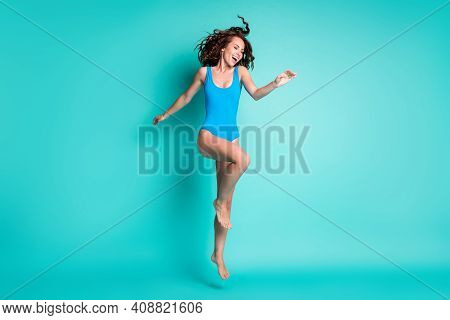 Full Size Photo Of Excited Energetic Girl Jump Enjoy Pool Party Chilling Weekend Wear Blue Swimwear