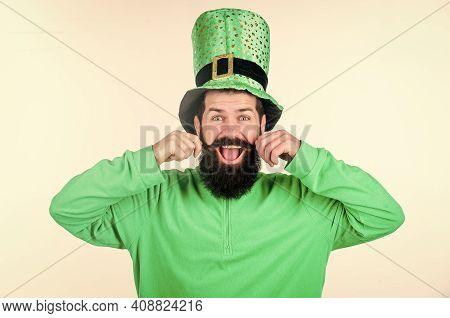 Enjoying The Prefect Mustache. Irish Man With Beard Twirling Mustache In Green Wear. Bearded Man Cel
