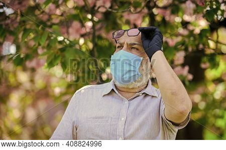 Pandemic Concept. Limit Risk Infection Spreading. Senior Man Wearing Face Mask And Gloves Outdoors.
