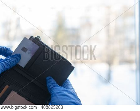 The Man Holding The Credit Card Pulled It Out Of His Wallet. For Business, Shopping, And Finance, Th