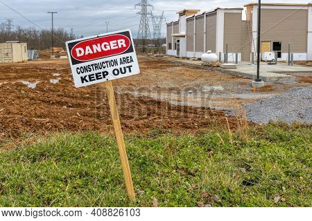 Horizontal Shot Of A Danger Construction Area Keep Out Sign Next To A Fast Food Restaurant Under Con