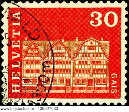 Moscow, Russia - February 13, 2021: Stamp Printed In Switzerland Shows Village Square Houses In Gais