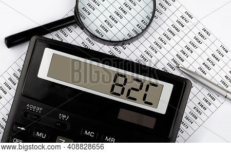 Word B2c On Calculator. Business And Tax Concept.
