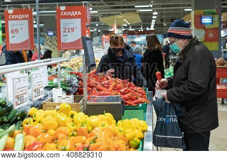 15.02.2021, Russia, Moscow. A Major Supermarket Ashan. Senior Buyer Chooses Vegetables.