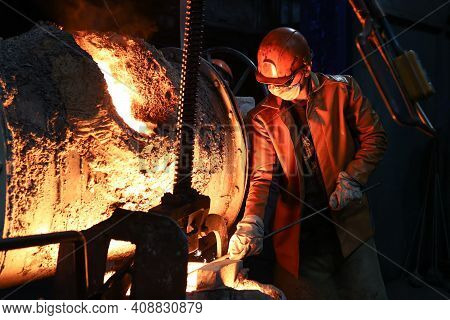 A Steelmaker Pours Pig Iron From A Blast Furnace, Sparks And Splashes Of Hot Metal Fly 4.