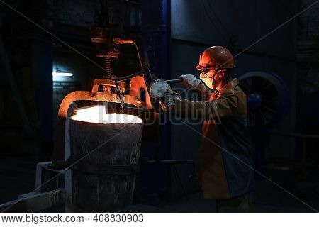 A Steelmaker Pours Pig Iron From A Blast Furnace, Sparks And Splashes Of Hot Metal Fly 3.