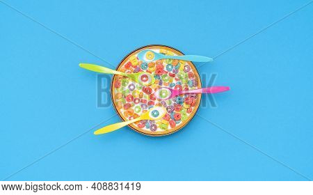 Top View With Multicolored Fruit Rings Cereals With Milk In A Bowl. Cereal Bowl With Four Multicolor
